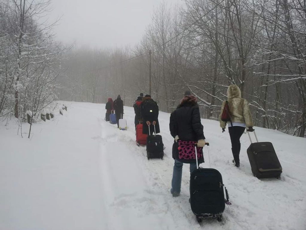 Budafest 2013 participants trying to make their way in the snow to the airport after the event